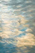 Blue sky reflections in a lake — Stock Photo