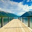 Jetty of a beautiful lake - Stock Photo
