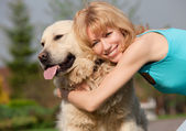 Friendship with a dog — Stock Photo