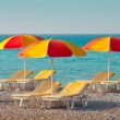 Sun beds and umbrellas — Stock Photo