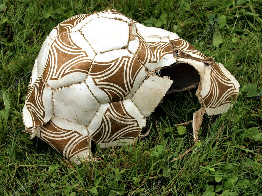  The broken off football on a green grass.     Stock Photo #4561602