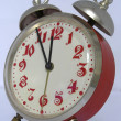 Red vintage alarm clock set to 11.55pm — Stock Photo