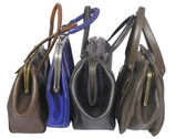 Varied old woman bags isolated on the white — Stock Photo