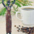 Statuette of a girl and coffee — Stock Photo