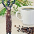 Stock Photo: Statuette of girl and coffee