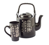 La tetera china negra y la taza sobre fondo blanco — Foto de Stock