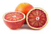 Full and two half of blood red oranges — Stock Photo
