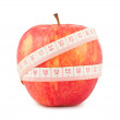 Red apple and measure tape — Stock Photo