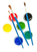 Brushes and colorful gouache paint — Stock Photo