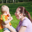 Stock Photo: Mother With Baby On Grass