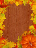 Fall leaves and pumpkins on wood background. EPS 8 — Stock Vector