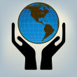 Stock Vector: Hands holding the world. EPS 8