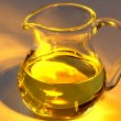 Glass jug with olive oil — Stock Photo