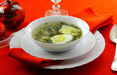 Soup with sorrel, potato and egg in the white soup plate — Stock Photo
