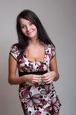 Brunet girl in color dress — Stock Photo