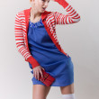Emotion pose blond girl in red woolly - Stok fotoraf