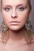 Attractive girl portrait wiht ethnic earring — Foto Stock