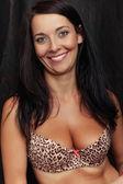 Attractive smile brunette girl in bra — Stock Photo