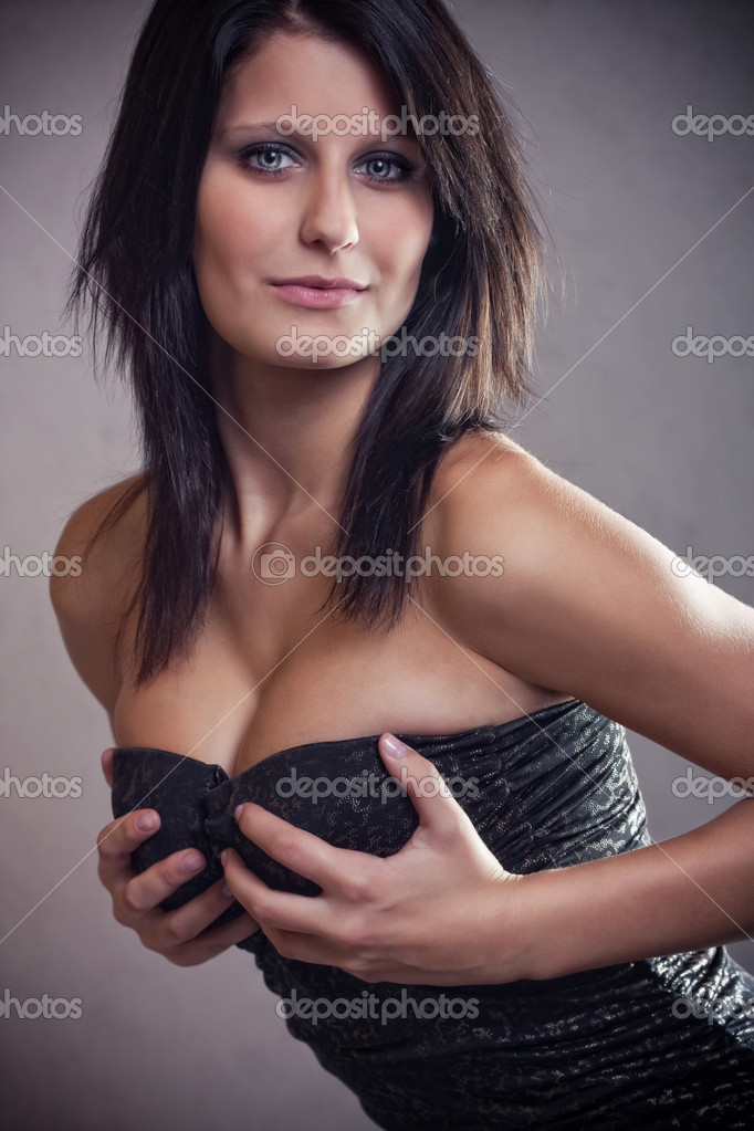 Attractive brunette girl in sexy dress — Stock Photo #4389549