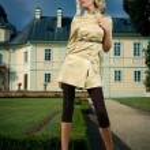 Attractive blonde girl in castle park — Stock Photo