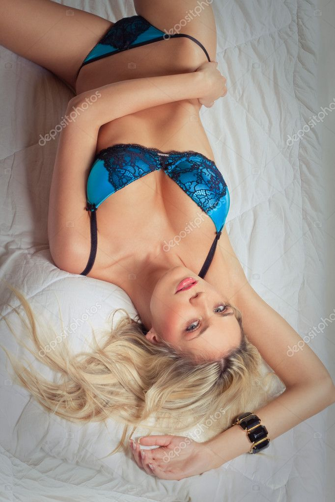Lying attractive blonde girl in blue lingerie — Stock Photo #4587908