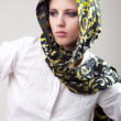 Attractive blond girl in scarf and white shirt — Stock Photo
