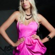 Attractive blond girl in pink dress — Stock Photo