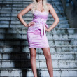 Attractive blond girl at stairs — Stock Photo