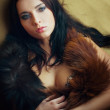 Lust attractive glamor girl with boa — Stock Photo