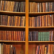 Stock Photo: Shelf of old books