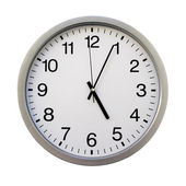 Five o'clock on the white wall clocks (isolated) — Stock Photo