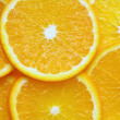 Stock Photo: Orange sliced pieces of background