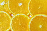 Orange sliced pieces of background — Stock Photo