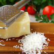 Cheese on a wooden board - Stock Photo