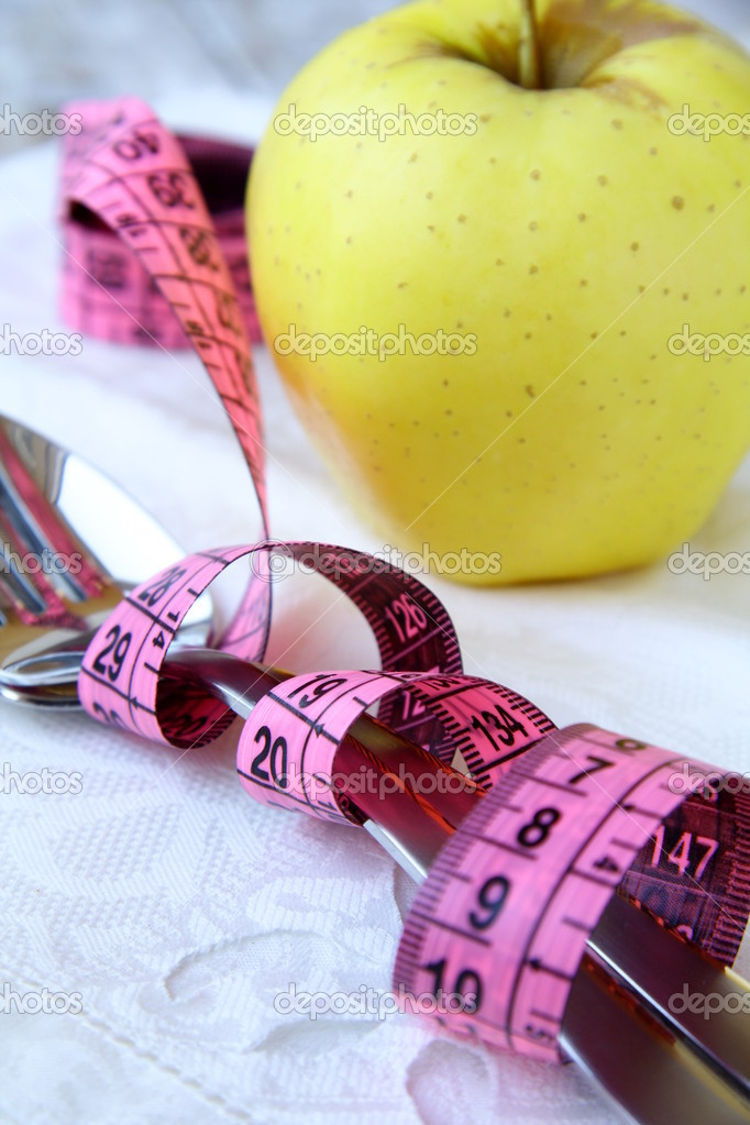 Tape measure wrapped around silver fork  — Stock Photo #4181246
