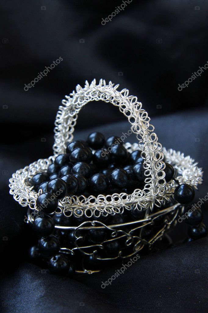 Jewelry pearls in a silver basket on a black background  — Stock Photo #4221126