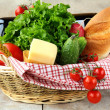 Picnic basket with fresh vegetables - Stock Photo