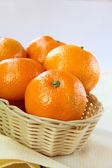 Fresh mandarin orange in a basket — Stock Photo