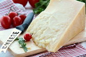 Cheese on a wooden board — Stock Photo