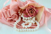 White pearls in a pink bag — Stock Photo