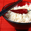 Stock Photo: White rice in a bowl with black chopsticks