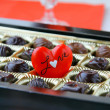 Chocolate with a red heart - Stock Photo