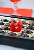 Chocolate with a red heart — Stock Photo