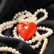 Stock Photo: Pearl white with red hearts