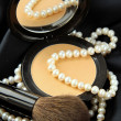 White pearl with powder in a box — Stock Photo