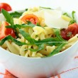Pasta salad with tomatoes and arugula - Stock Photo