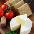 Delicatessen soft cheese with bread, tomatoes — Stock Photo