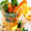 Tea with orange and branches of mint — Stock Photo