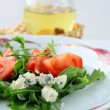 Salad with tomatoes and blue cheese - Stock Photo