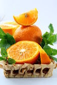 Orange and orange segments and mint — Stock Photo